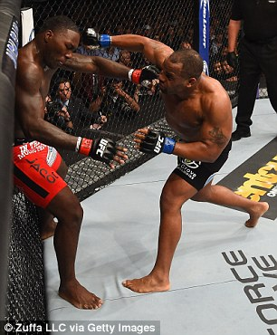 2905EEA500000578-3094785-Daniel_Cormier_punches_Anthony_Johnson_who_is_backed_up_against_-a-7_1432454608859.jpg