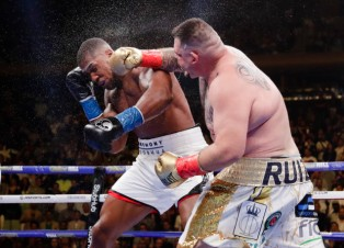 Andy Ruiz, right, punches Anthony Joshua during the seventh round of a heavyweight championship boxing match Saturday, June 1, 2019, in New York. Ruiz won in the seventh round. (AP Photo/Frank Franklin II)